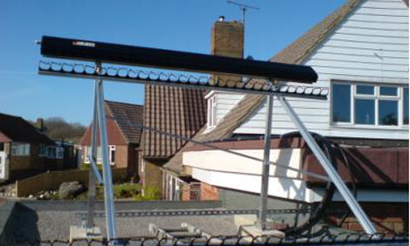 A solar hot water frame on the flat roof of Ann Link's home