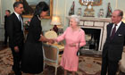 Barack Obama and his wife talk with Queen during an audience at Buckingham Palace in London