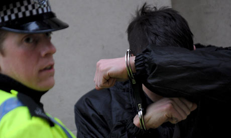 Police arrest a G20 protester outside the London Stock Exchange