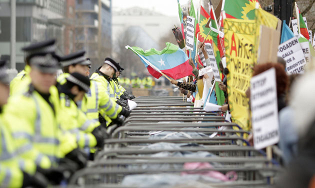 G20 protests day two: Police patrol barriers around demonstrators near ExCeL Centre in London.