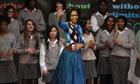 Michelle Obama during a visit to Elizabeth Garrett Anderson Language School in London