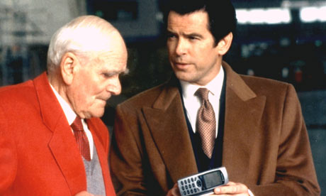Pierce Brosnan as James Bond and Desmond Llewelyn as Q