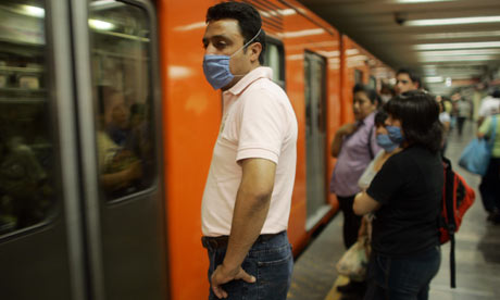 People wearing surgical masks against swine flu in the Mexico City subway