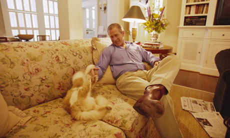 George Bush playing with cat