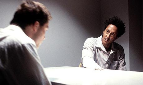 Dominic West as McNulty and Andre Royo as Bubbles in The Wire
