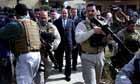 Iraqi Prime Minister Nuri al-Maliki surrounded by his bodyguards