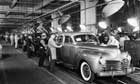 Workers Inspecting Chrysler Imperials on Assembly Line