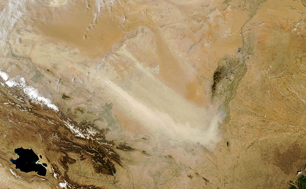 Minqin China: Tan plumes of dust swept across the Tengger Desert