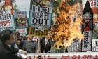 Protesters burn a portrait of Kim Jong-il after North Korea's nuclear test