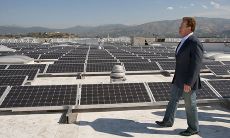 Arnold Schwarzenegger tours a solar panel installation