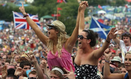 Music fans cheer at the Glastonbury Festival 2008