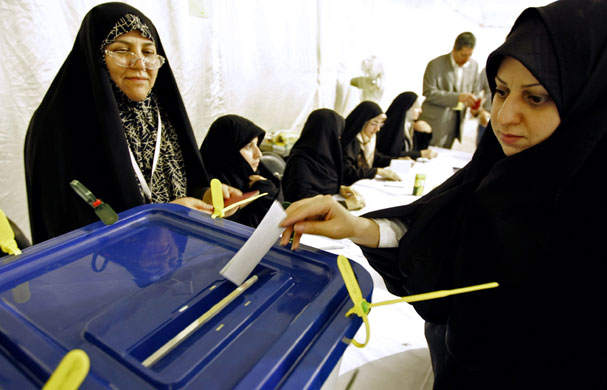 Iraninan elections: A woman casts her ballot at the Iranian Consulate in Dubai