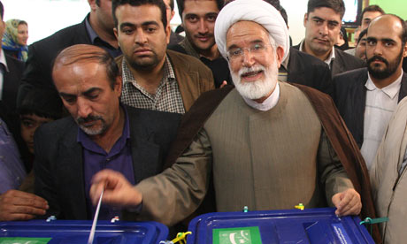 Iranian presidential candidate Mehdi Karroubi votes at a polling station in Tehran, June 12, 2009.