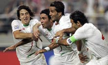Iran's Masoud Shojaye celebrates scoring a goal