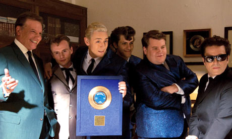 Con O'Neill as Joe Meek celebrates chart success with his young pop stars in the film 'Telstar'
