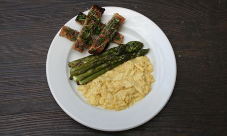 Roast asparagus with scrambled eggs and buttery anchovy toast