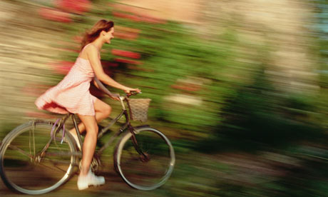 Bike Blog: A woman enjoying a bike ride with a dress