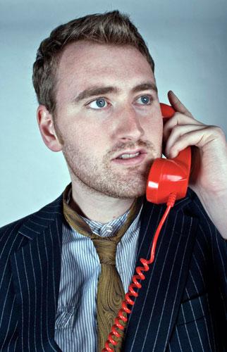 Michael Clough Portfolio: 'The Red Telephone' portrait shot of man on old fashoined - Michael-Clough-Portfolio--003