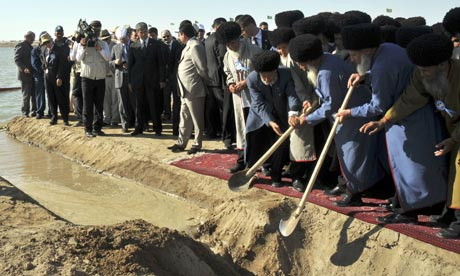 Turkmen elders open a drain channel to start filling the country's Golden Age Lake.