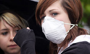 Pupils gather outside Downend school in Bristol after it was closed due to swine flu