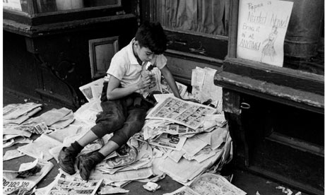 Boy reading newspaper, New York, 1944
