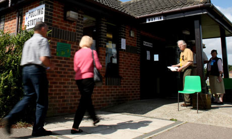 Voters arrives at a polling station to have their say in Norwich North byelection on 23 July 2009