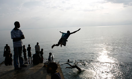 Youngsters dive into the waters of Lake Kivu at Kisegi
