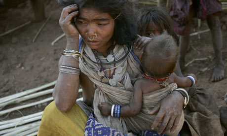 A tribal woman with her child near the mining site of the alumina refinery in Orissa state. Photograph: Parth Sanyal /Reuters