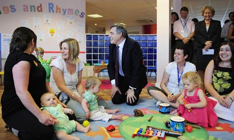 Gordon Brown with youngsters during a visit to a children's playgroup at Sherburn near Leeds