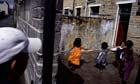 Asian children playing in a backyard