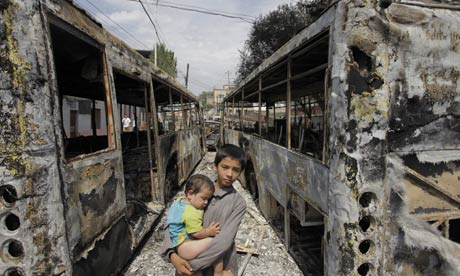 Burnt out buses after disturbances in Urumqi, capital of Xinjiang province in China.