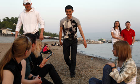 Youngsters socialising on the Russia-China border