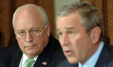 President George W Bush speaks to the media as Vice President Dick Cheney listens