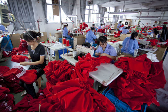 Christmas production line: Workers sew Christmas products at the Yiwu Spaceflight craftwork company