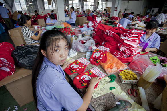 Christmas production line: Workers assemble Christmas stockings on the production line in Yiwa China