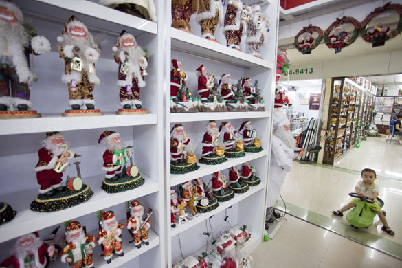 Christmas production line: Santa figures for sale at the Yule Sun Factory wholesale store in Yiwu