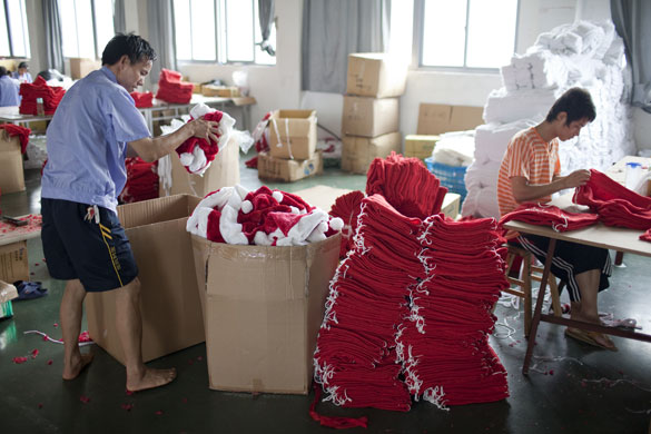 Christmas production line: Santa hats are packed into boxes from the  production line in Yiwa
