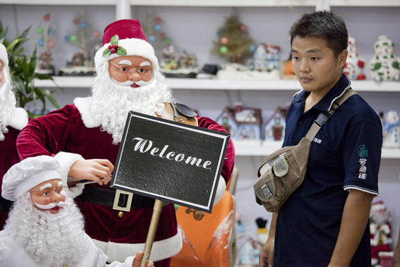 Christmas production line: Santas for sale at the Yule Sun Factory wholesale store in Yiwu