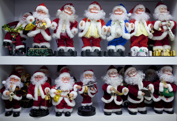 Christmas production line: Musical Santa figures for sale at the Yule Sun wholesale store in Yiwu