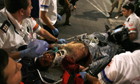 Israeli paramedics with wounded man in Tel Aviv