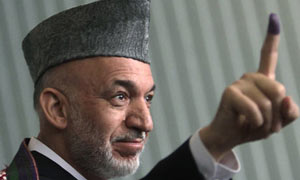 Afghan President Hamid Karzai casts his vote