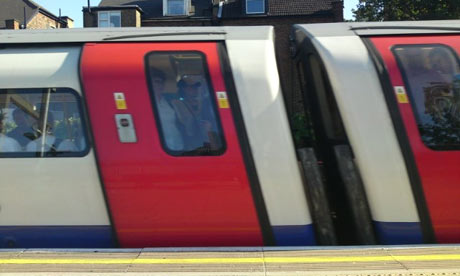 A London Underground tube train arriving at West Hampstead tube station. Photograph: Paul Owen.