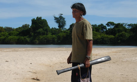 Melobo, shaman, standing on Xingu river
