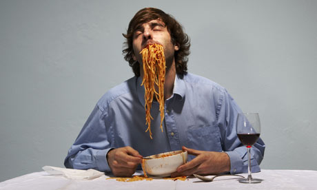 Man eating spaghetti
