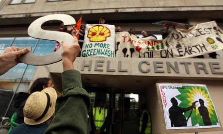 Protesters from the Camp for Climate Action demonstrate at Shell headquarters , London