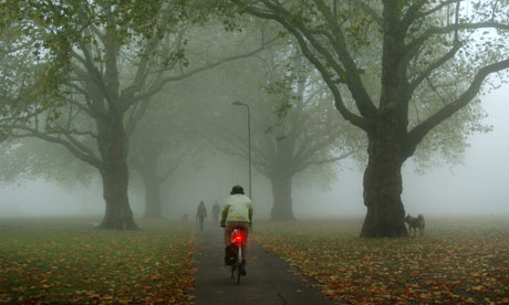 Bike blog: Cyclist commuting by a Foggy Morning In A Park In Hackney, London