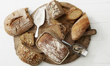 Various breads on a breadboard