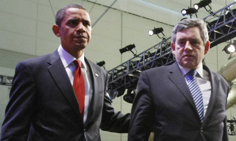 Barack Obama and Gordon Brown walk off stage after delivering a joint statement