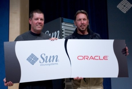 Scott McNealy and Larry Ellison with logos