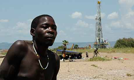 Fishermen near an oil rig on the edge of Lake Albert in western Uganda
